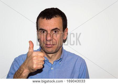 Man smiling showing finger up warning against white background