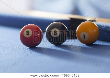 Red, yellow and black billiard balls in a pool table. Focus on all billiard balls