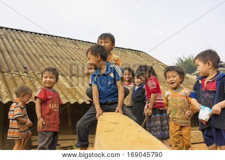 Ha Giang, Vietnam - Apr 12, 2014: Unidentified Hmong children playing on playground in front of there houses under sunlight. The Hmong are an Asian ethnic group from the mountainous regions