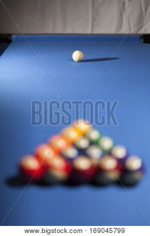 Pool billiard balls in commonly used starting position. Focus on white billiard ball