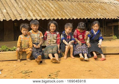 Yen Bai, Vietnam - Apr 12, 2014: Unidentified Hmong children playing on playground in front of there houses under sunlight. The Hmong are an Asian ethnic group from the mountainous regions