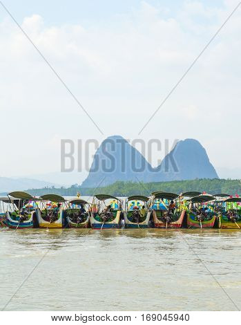longtail boat waiting tourist on andaman ocean thailand