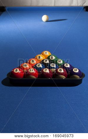 Pool billiard balls in a plastic rack - commonly used starting position. All billiard balls focused
