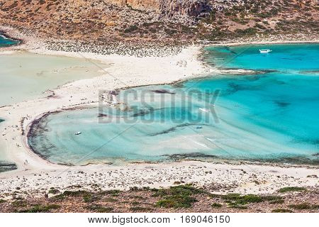 Wonderful sea lagoon with clear turquoise water on a bright sunny day looks like a paradise. Balos bay on Crete island Greece.