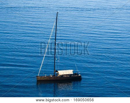 Don't let others' behaviour disturb your inner peace  A sailboat floating over the peaceful sea...