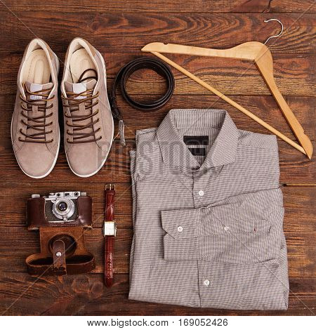 Flat Lay Of Modern Men's Clothing On A Brown Wooden Background