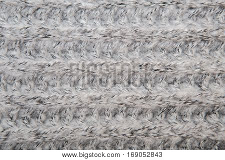 Gray Melange Fluffy Woven Thread Sweater Or Scarf As A Background.