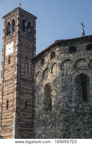 Agliate Brianza (Monza Lombardy Italy): exterior of the medieval church of Saints Peter and Paul built from the 11th century: baptistery and belfry