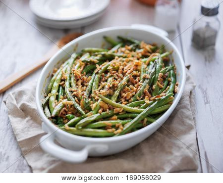 baked green bean casserole topped with french fried onions