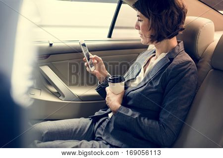 Businesswoman Using Smart Phone Car Inside