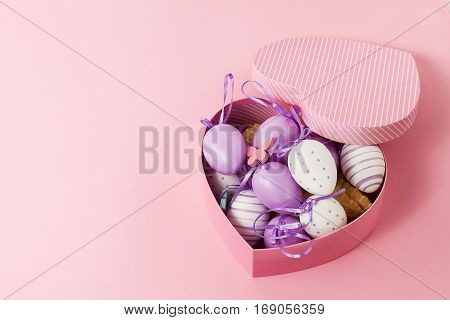 Easter or Spring Concept. Easter Eggs in Beautiful Heart Shaped Gift Box. Top view.