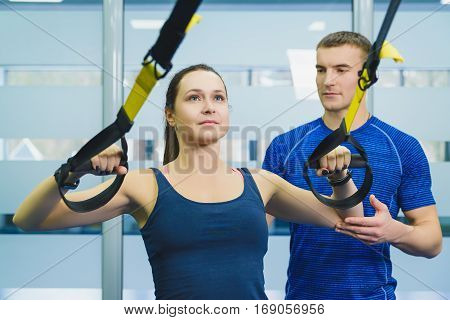 sporty woman and man doing gymnastic exercises or exercising in fitness class.