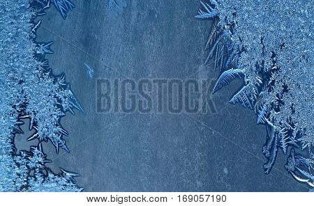 Winter frost on window glass for background