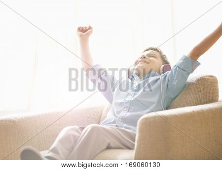 Boy sitting and reclining in a comfy chair