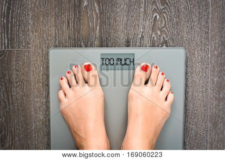 Too much text written on a weight scale suggesting nutrition problems or healthy eating concept