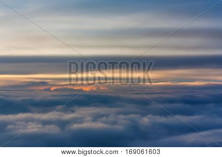 Skyscape of sunset viewed from board of airplane