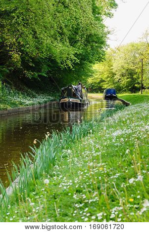 CHIRK UNITED KINGDOM - APRIL 30 2011: Narrowboats on the Llangollen branch of the Shropshire Union canal a popular holiday getaway for families and tourists to enjoy the extensive inland waterway network