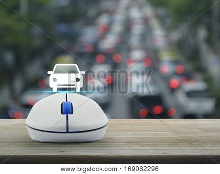 Car flat icon with wireless computer mouse over blur of rush hour with cars and road Internet transportation service concept