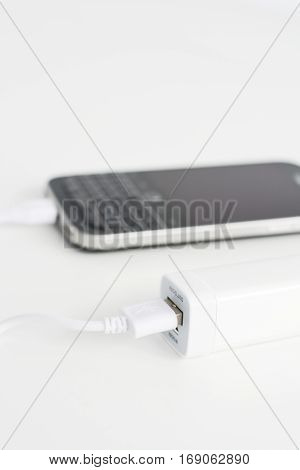 Mobile phone portable battery recharging a smartphone