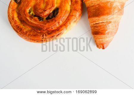 Close up on croissants, Danish pastry and chocolate and raisin filled pastries
