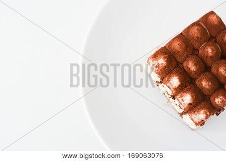 Tiramisu coffee cake served on a white plate