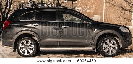 Kazakhstan, Ust-Kamenogorsk, 22 january, 2017: Chevrolet Captiva, side view, black car