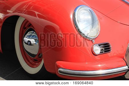 Close-up of headlights of white vintage car. Headlamp in classic luxury car. Headlight of vintage car close-up.
