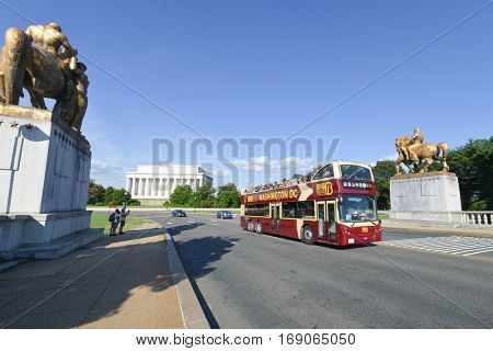 WASHINGTON, DC - JUNE 23, 2013: A tourist bus as seen on Arlington Memorial Bridge with Lincoln Memorial background.