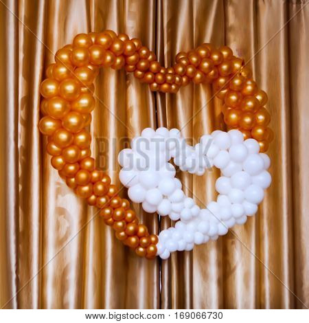 Colored balloons heart shape indoor brown and ochre