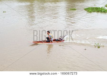 PRACHINBURI, THAILAND-FEBRUARY 5, 2017:The young man was driving the boat at the boat races in Bang Pakong River.