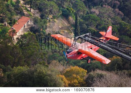 Barcelona Spain - January 03 2017: The plane-carousel in an amusement park on the Tibidabo hill in Barcelona
