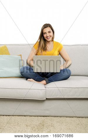 Beautiful woman at home working with her laptop