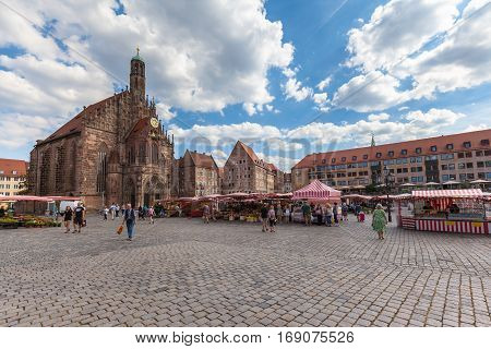 Nuremberg Germany - September 2 2016 - View of the Hauptmarkt with the Frauenkirche church and the marketplace in Nuremberg Bavaria Germany.