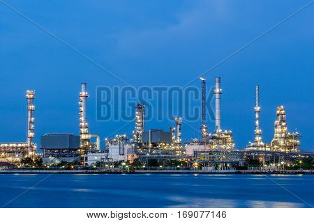 Oil refinery plant of Petrochemistry industry in twilight time gas and oil production processing in Bangkok Thailand.