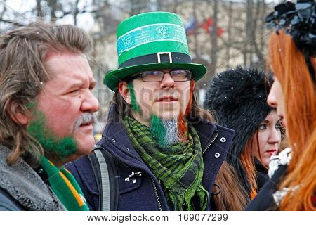 Moscow Russia - March 19 2016: Participant in the Irish hat and with beard the color of the Irish flag at the St. Patrick's Day Parade in the park Sokolniki in Moscow