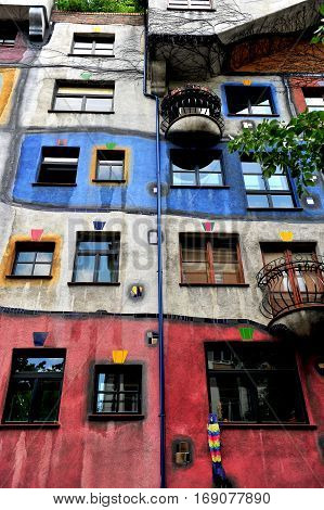 VIENNA AUSTRIA - JUNE 6: Vertical view of Hundertwasser house in Vienna on June 6 2016. Vienna is the capital and largest city of Austria.