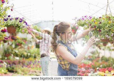 Attractive Gardener in a garden centre