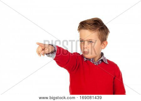 Blond child with red jersey pointing with his finger isolated on white background