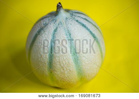 Cantaloupe Melone on yellow background, healthy, sweet