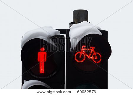 front view close of stop red pedestrian and bicycle traffic light covered in snow in winter time
