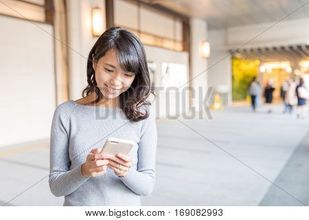 Woman using cellphone to text message