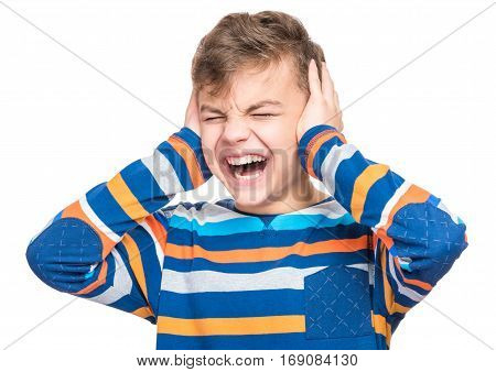 I can not hear anything - portrait of a teen boy 12-14 year old. Half-length emotional portrait of caucasian teenager screaming. Handsome outraged child shouting out loud, isolated on white background.
