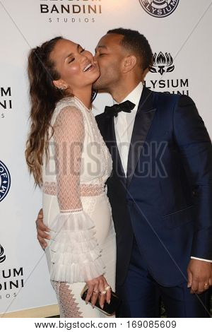 LOS ANGELES - JAN 7:  Chrissy Teigen, John Legend at the Art of Elysium 10th Annual Black Tie Heaven Gala at Red Studios on January 7, 2017 in Los Angeles, CA