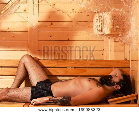 Handsome Man Relaxes In Sauna