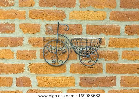 Ornament handicraft bicycle miniature hanging on brick wall