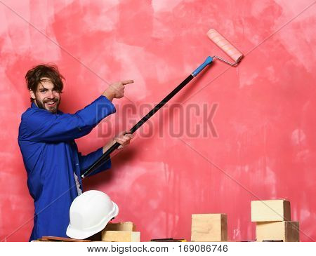 Smiling Man Holding Paint Roller