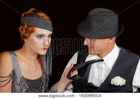 beautiful flapper girl pull gangster on his tie