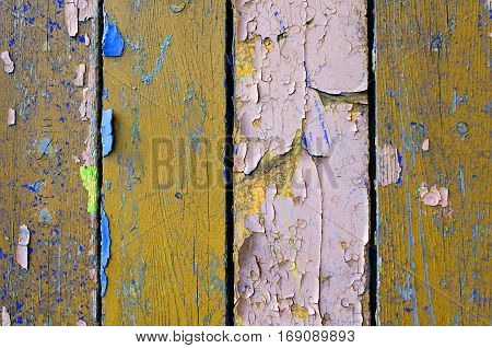 Texture background of old wooden texture painted surface with peeling brown and purple texture paint. Texture of peeling paint on the wood. Old wooden texture background surface.Rough peeling paint texture background. Wooden texture background