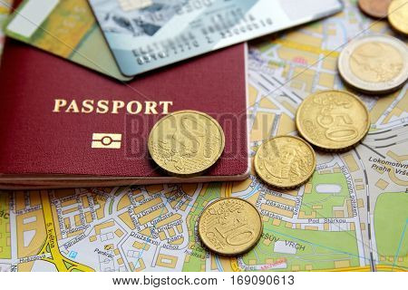 credit cards passport coins and map close-up view. travel concept.