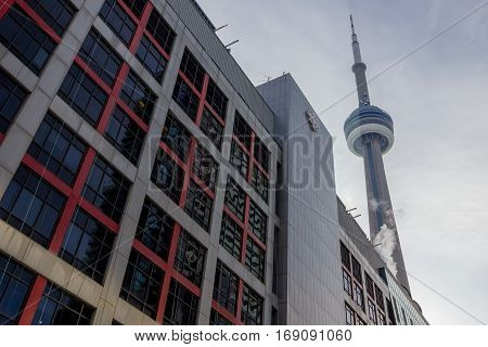 Toronto, Canada - December 20, 2016: Ontario headquarters of the Canadian Broadcasting Corporation into the light with the CN Tower behind